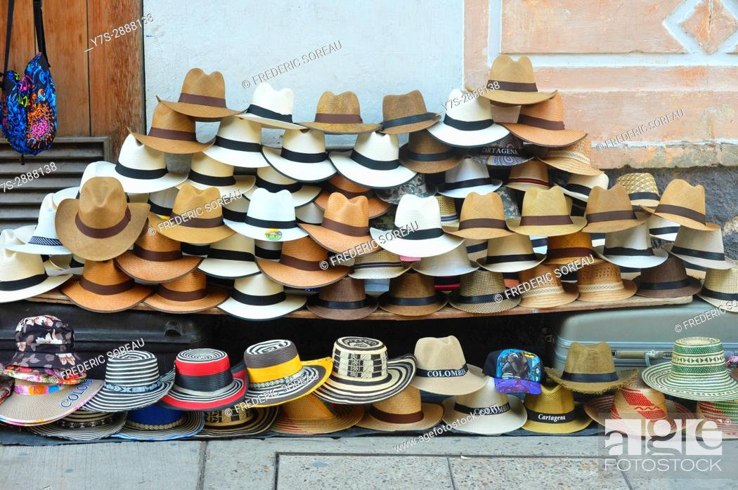 Stock Photo: A pile of colombian sombrero's at a street vendors stand in Cartagena, Colombia, South America.