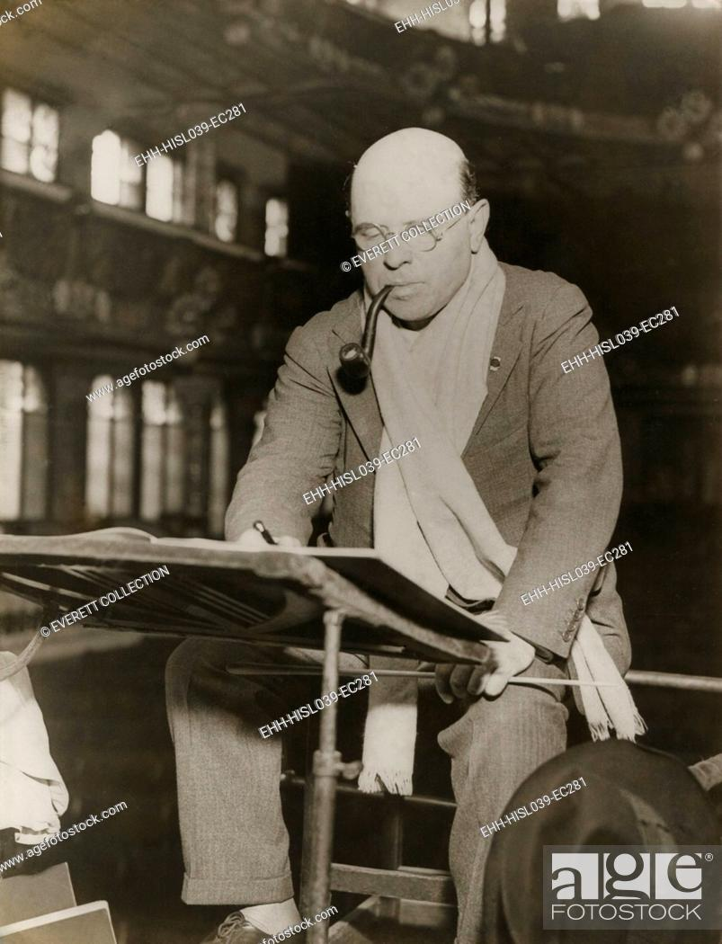 Stock Photo: Pablo Casals at rehearsal conducting the Barcelona Philharmonic Orchestra. Casals generally appears at rehearsal in a scarf around his neck and a pipe between.
