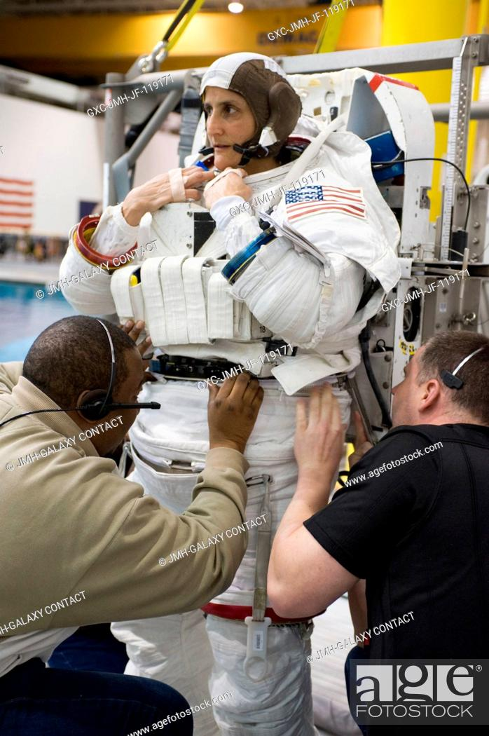 Stock Photo: NASA astronaut Sunita Williams, Expedition 32 flight engineer and Expedition 33 commander, gets help donning a training version of her Extravehicular Mobility.