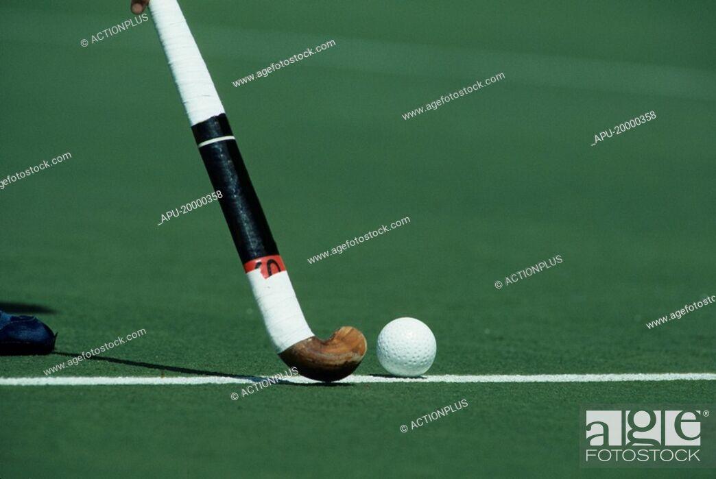 Stock Photo: Field hockey stick and ball.