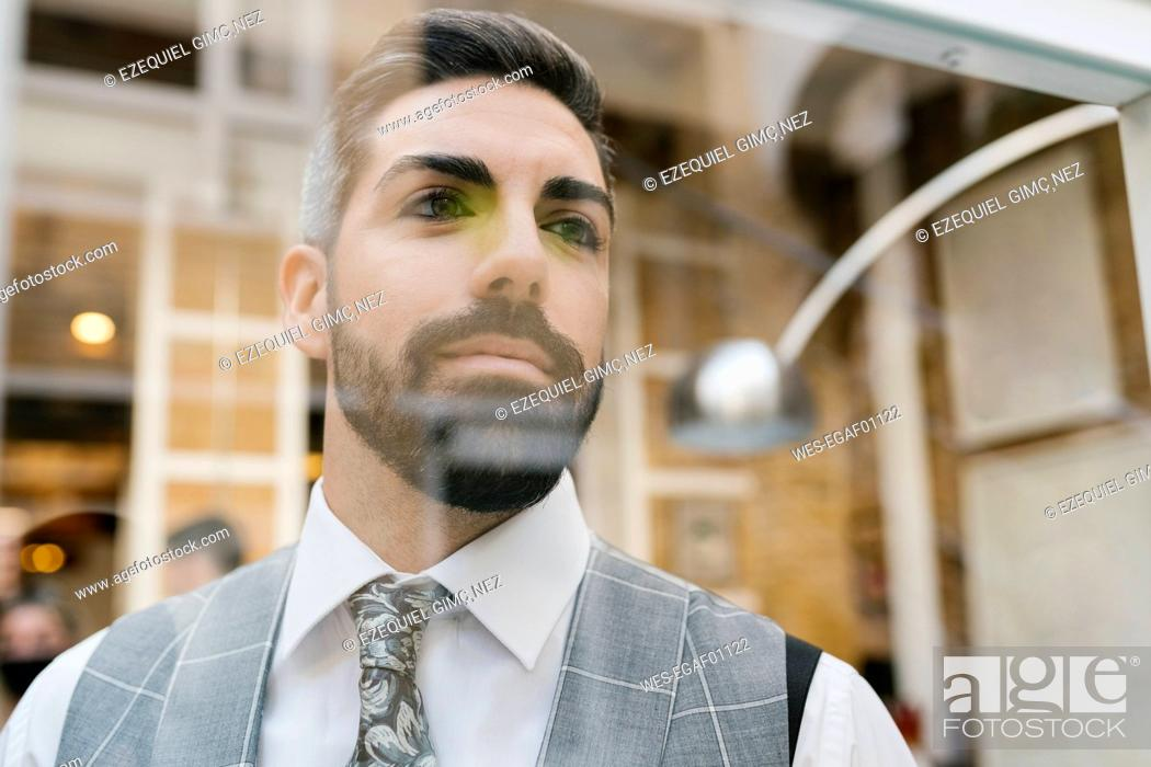 Stock Photo: Handsome groom seen through glass material at home.