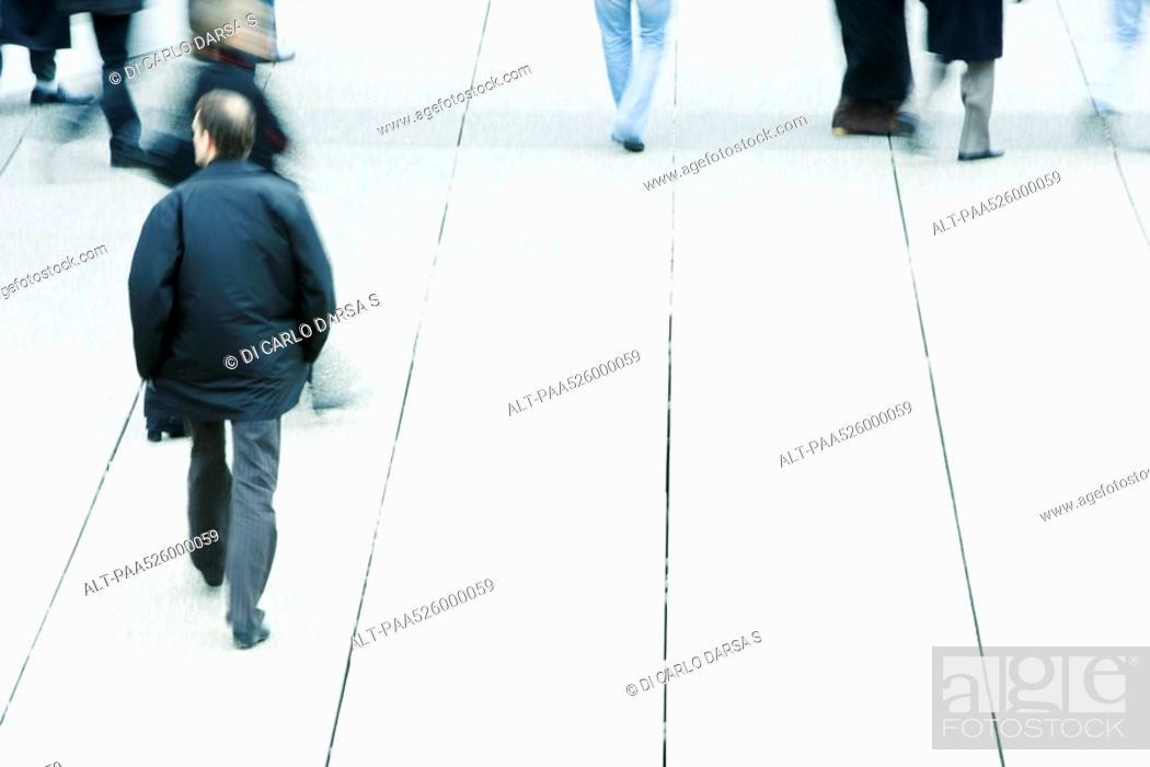 Stock Photo: Pedestrians on sidewalk.