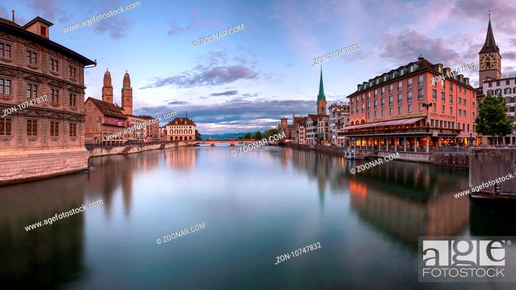 Stock Photo: ZURICH, SWITZELAND - 04 June, 2016: Zurich Skyline and Limmat River. The river commences at the outfall of Lake Zurich, in the centre of the city of Zurich.