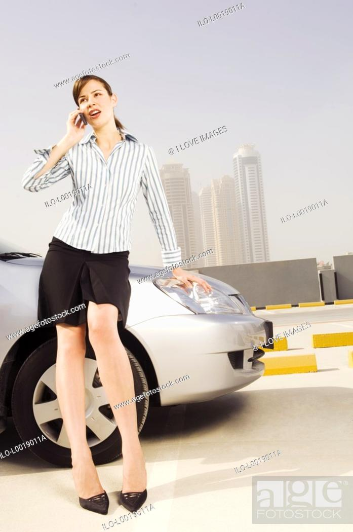 Stock Photo: A businesswoman talking on a mobile phone.
