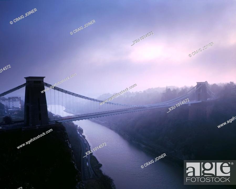 Stock Photo: Clifton Suspension Bridge over the River Avon in the Avon Gorge in winter fog just after sunset  Bristol, England, United Kingdom.