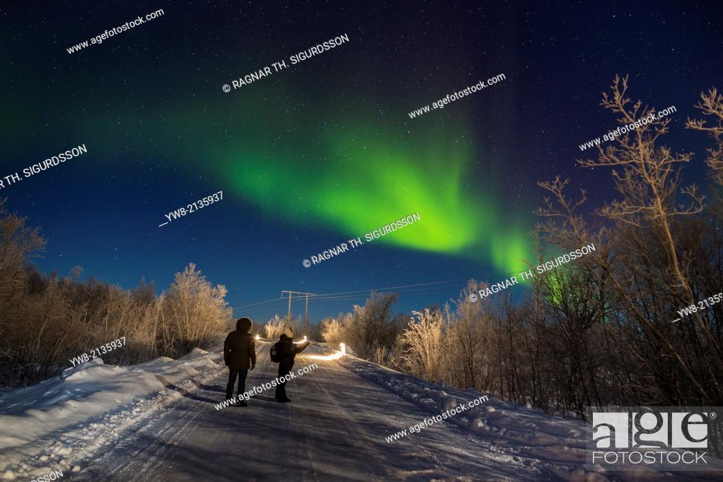 Stock Photo: People enjoying the Aurora Borealis or Northern Lights, Lapland, Sweden.