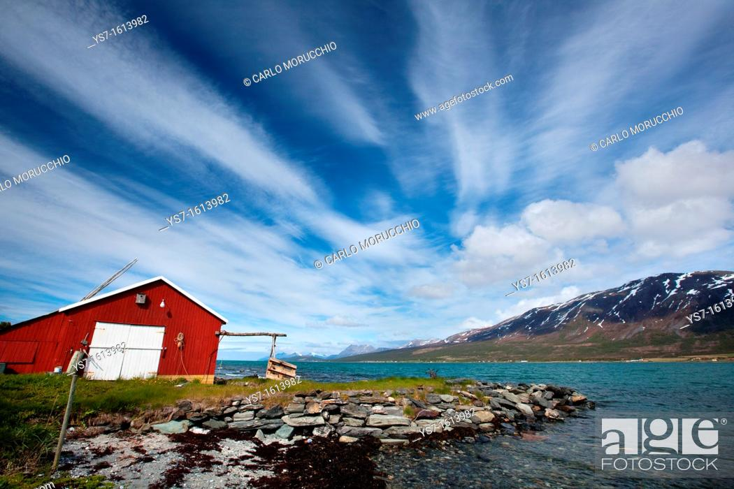 Stock Photo: Cabin overlooking a fjord and snowy mountains in Lyngen Peninsula, Troms county, Norway, Europe.