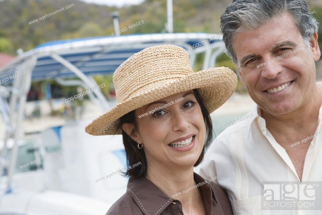 Stock Photo: Couple smiling by yacht.