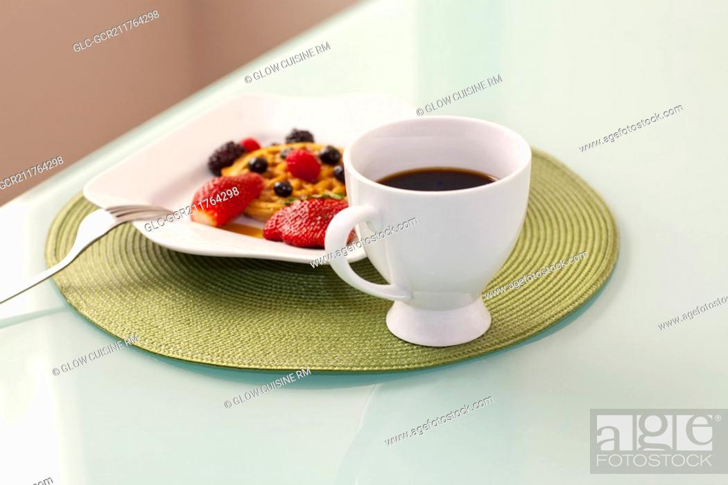 Stock Photo: High angle view of strawberries with waffles and a cup of coffee.