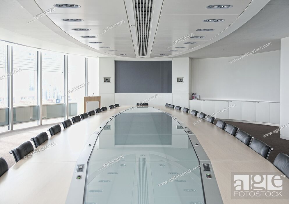 Stock Photo: Television and large table in modern conference room.