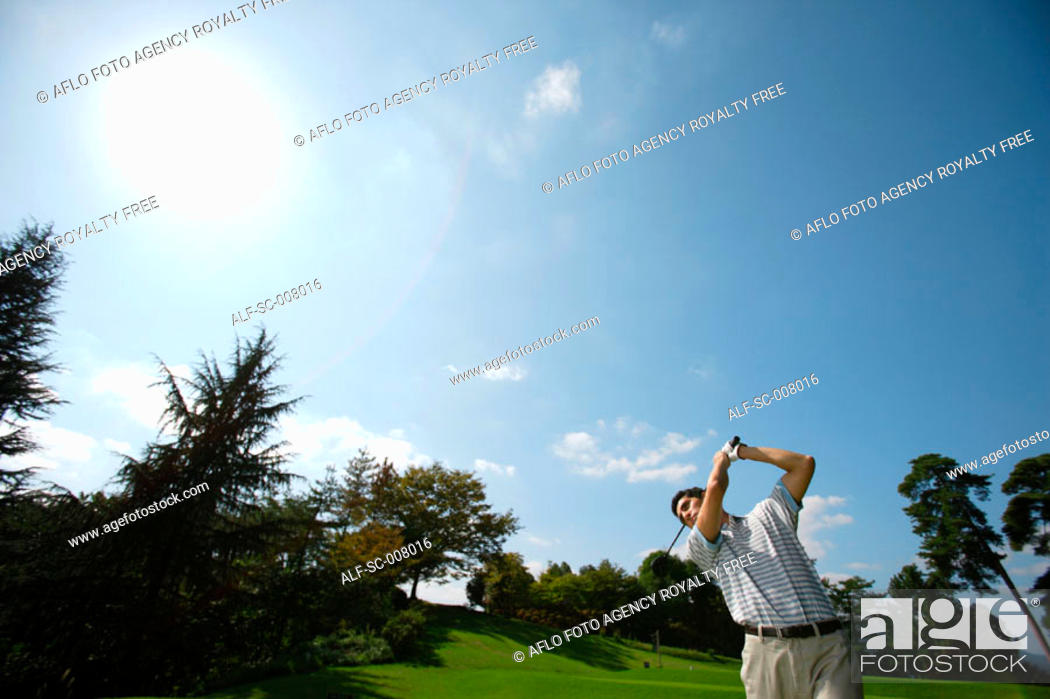 Stock Photo: Man making a golf stroke with full strength.