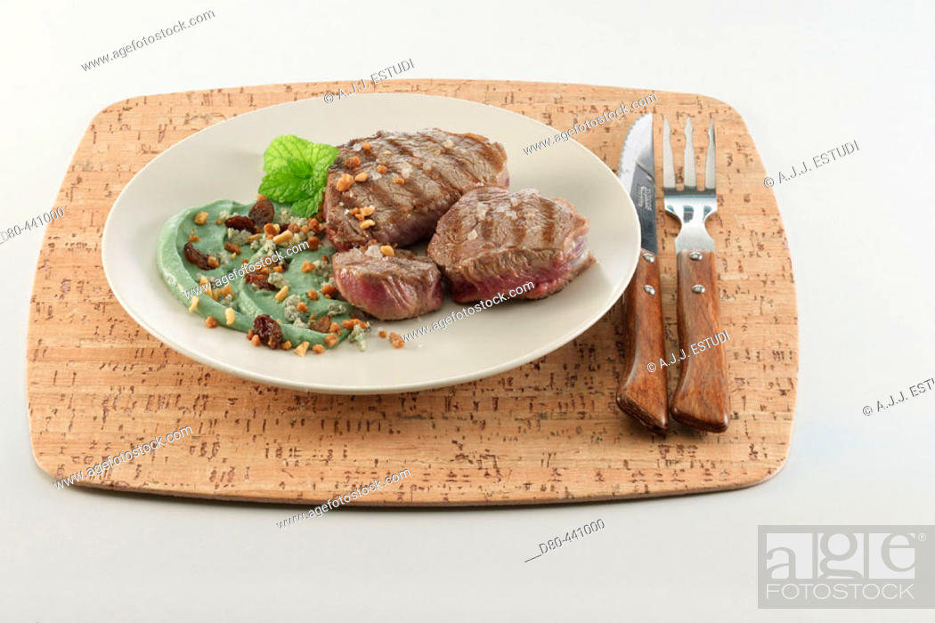 Stock Photo: Faux filet with cream of blue cheese and raisins.