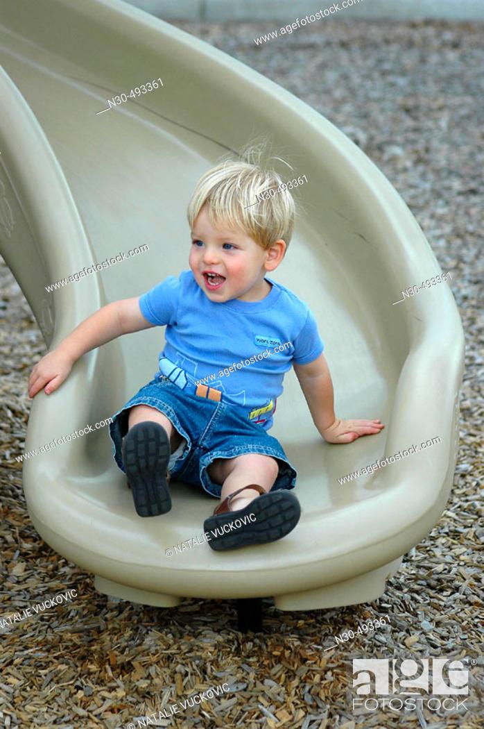 Stock Photo: Toddler Boy on Slide.