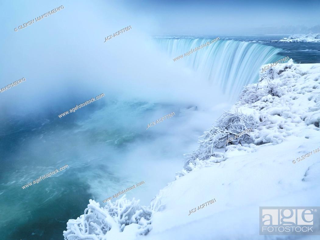 Stock Photo: Niagara Falls Horseshoe waterfall covered with snow, wintertime scenic. Ontario, Canada.