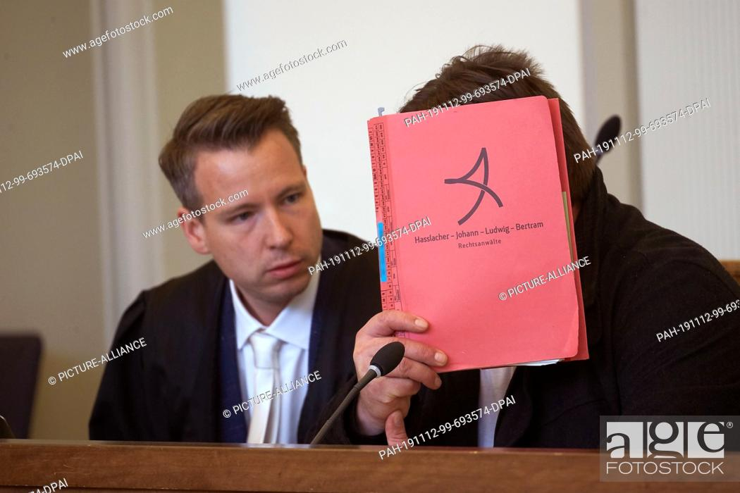 Stock Photo: 12 November 2019, Rhineland-Palatinate, Koblenz: The 46-year-old defendant (r) sits in a courtroom of the Regional Court next to his lawyer Axel Bertram.