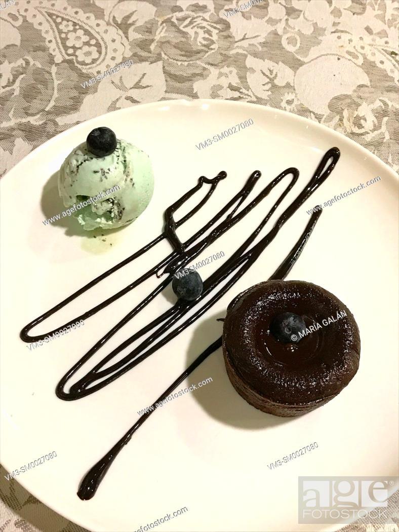 Stock Photo: Chocolate cake with mint ice cream.