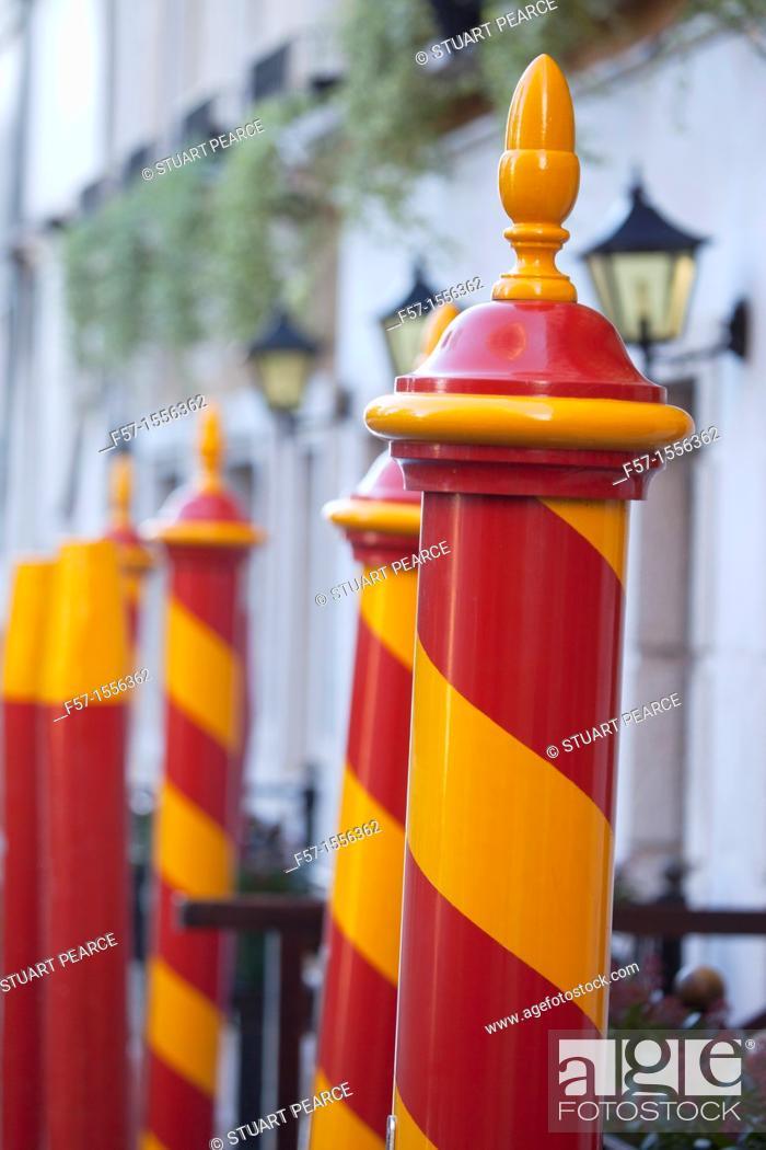 Stock Photo: Gondola mooring poles in Venice, Italy.