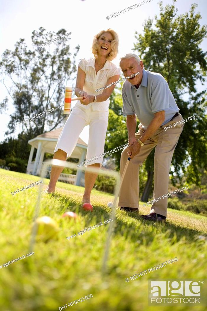 Stock Photo: A couple playing croquet.