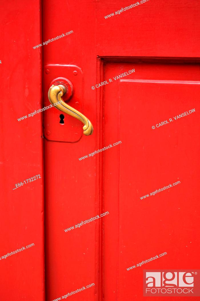 Stock Photo: red door with curved brass handle - shot straight on.