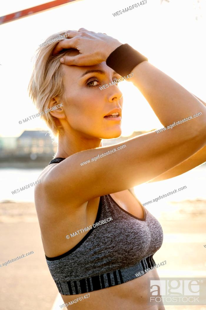 Photo de stock: Portrait of blonde sportswoman, hands in hair.