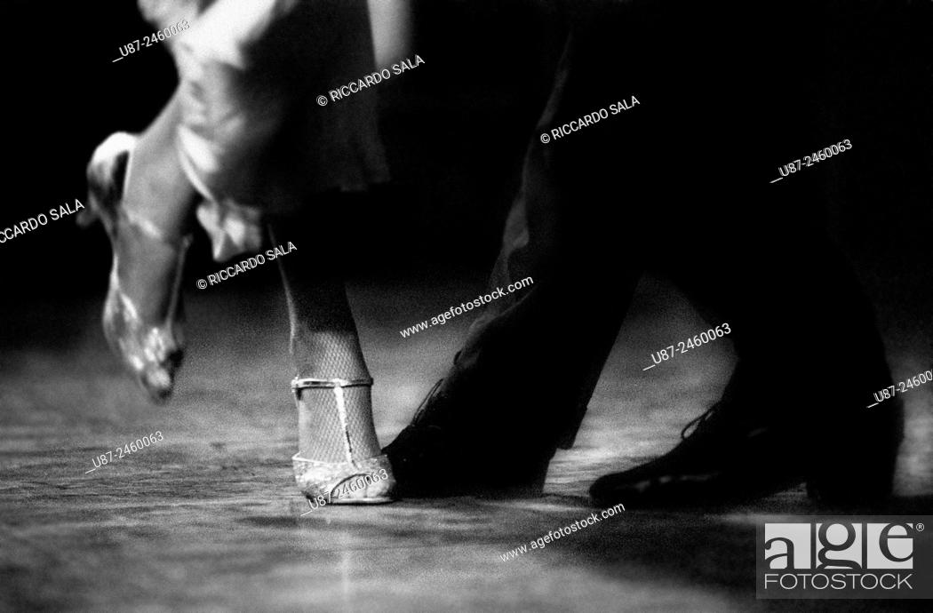 Stock Photo: Feet Detail of Couple Dancing Argentinian Tango. . . .