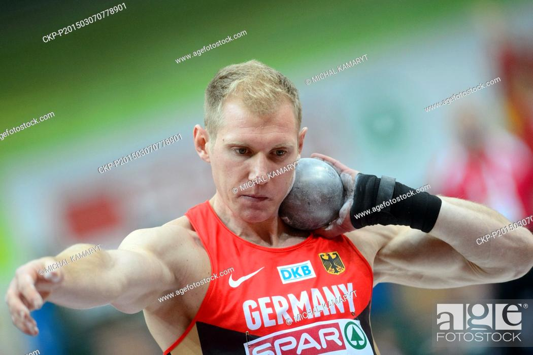 Stock Photo: Germany's Arthur Abele makes an attempt in the shot put of the men's heptathlon during the European Athletics Indoors Championships in Prague, Czech Republic.