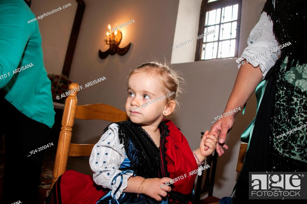 Stock Photo: This young girl, is waiting for put the handkerchief. The way she hold the finger of her mother, we note That the contact needs to feel safer. Llanes.