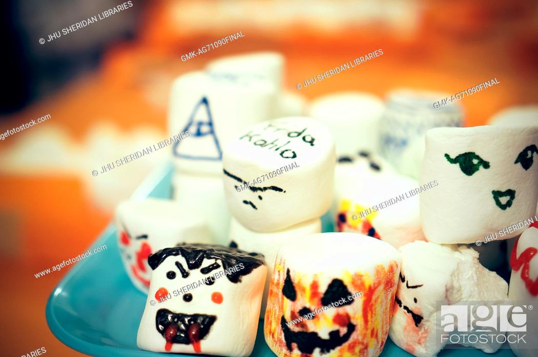 Imagen: Close up photo of a plate of large marshmallows that have been decorated with faces, Halloween at Johns Hopkins University's George Peabody Library, 2015.