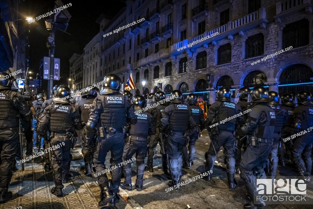 Stock Photo: Police officers confront protesters during the demonstration. Thousands of pro-independence protesters from Catalonia have gathered in front of the national.