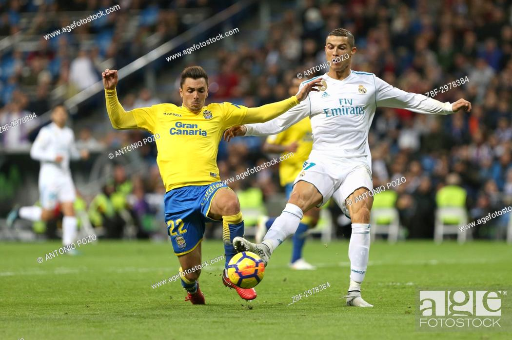 Stock Photo: MADRID, SPAIN. November 05, 2017 - Ximo Navarro and Cristiano Ronaldo. Real Madrid defeated Las Palmas 3-0 with an spectacular goal from Asensio with Casemiro.