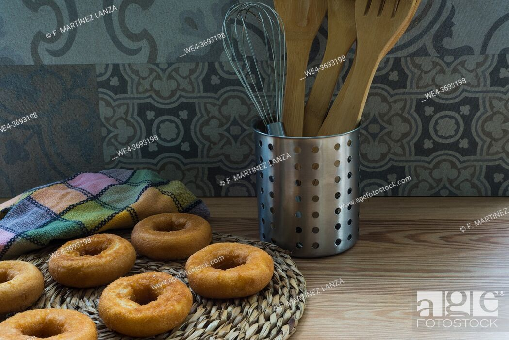 Stock Photo: Fried doughnuts on a table.