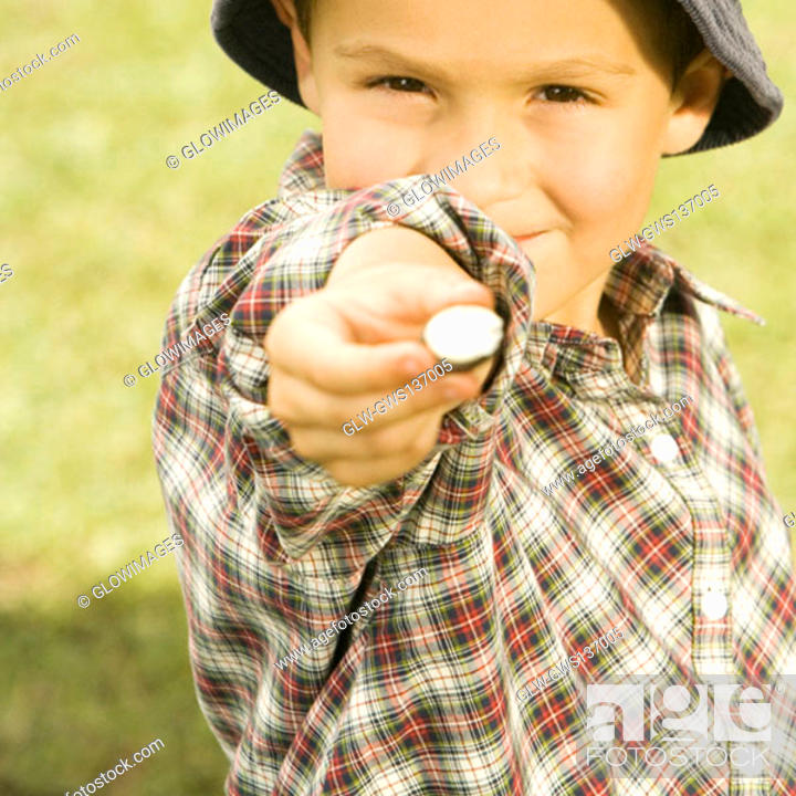 Stock Photo: Close-up of a boy holding a candy.