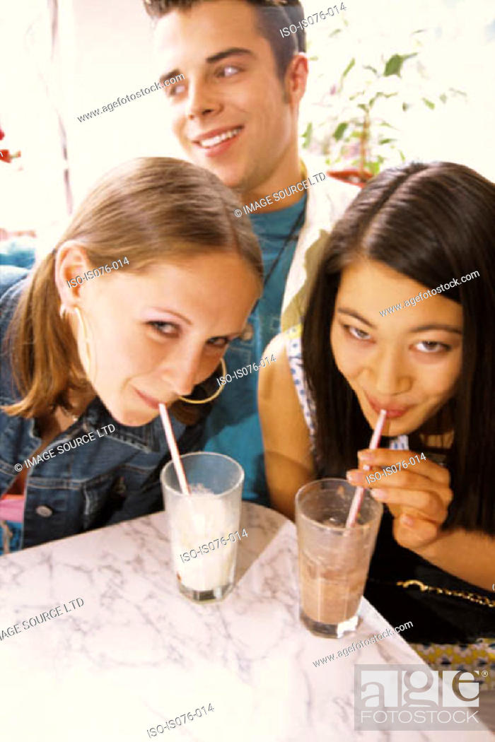 Stock Photo: Girls drinking milkshakes.