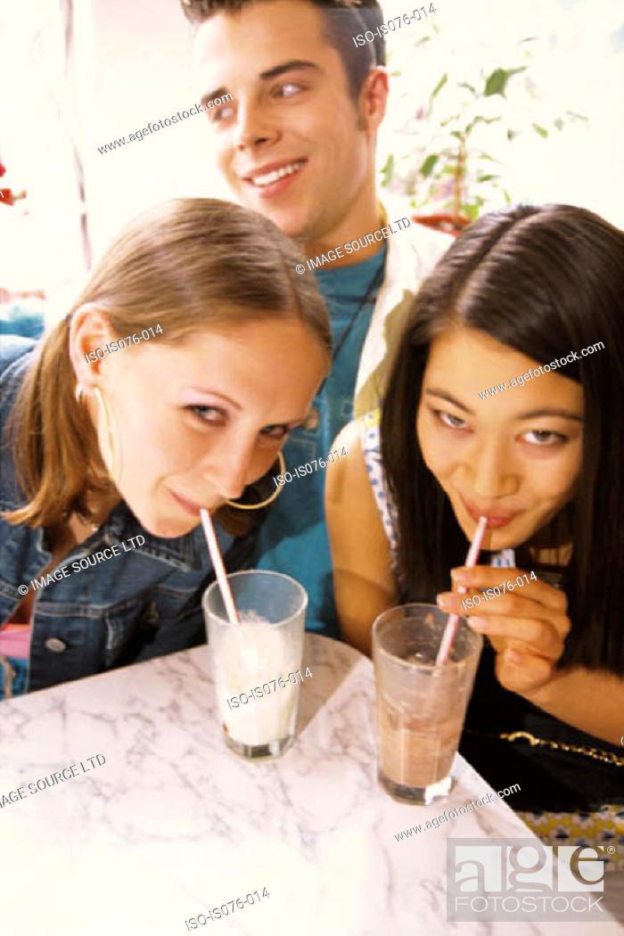 Stock Photo: Girls drinking milkshakes.