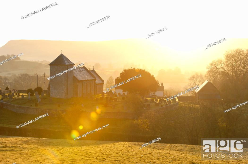 Stock Photo: A view at sunrise of Saint David's Church in the tiny hamlet of Llnddewi'r Cwm, Powys, Wales, UK.