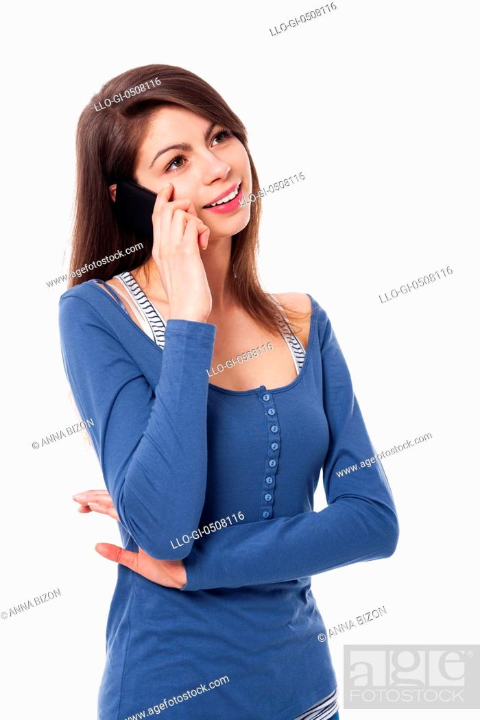 Stock Photo: Pretty woman in conversation on cell phone Debica, Poland.