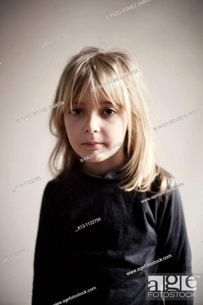 Stock Photo: Portrait of serious girl.