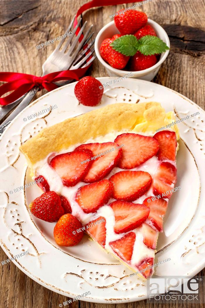 Stock Photo: Piece of strawberry tart on rustic wooden table. Festive and party dessert.