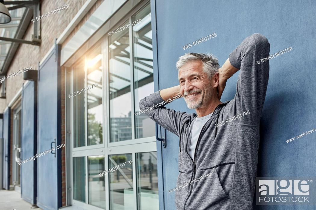 Stock Photo: Portrait of laughing mature man in front of gym.
