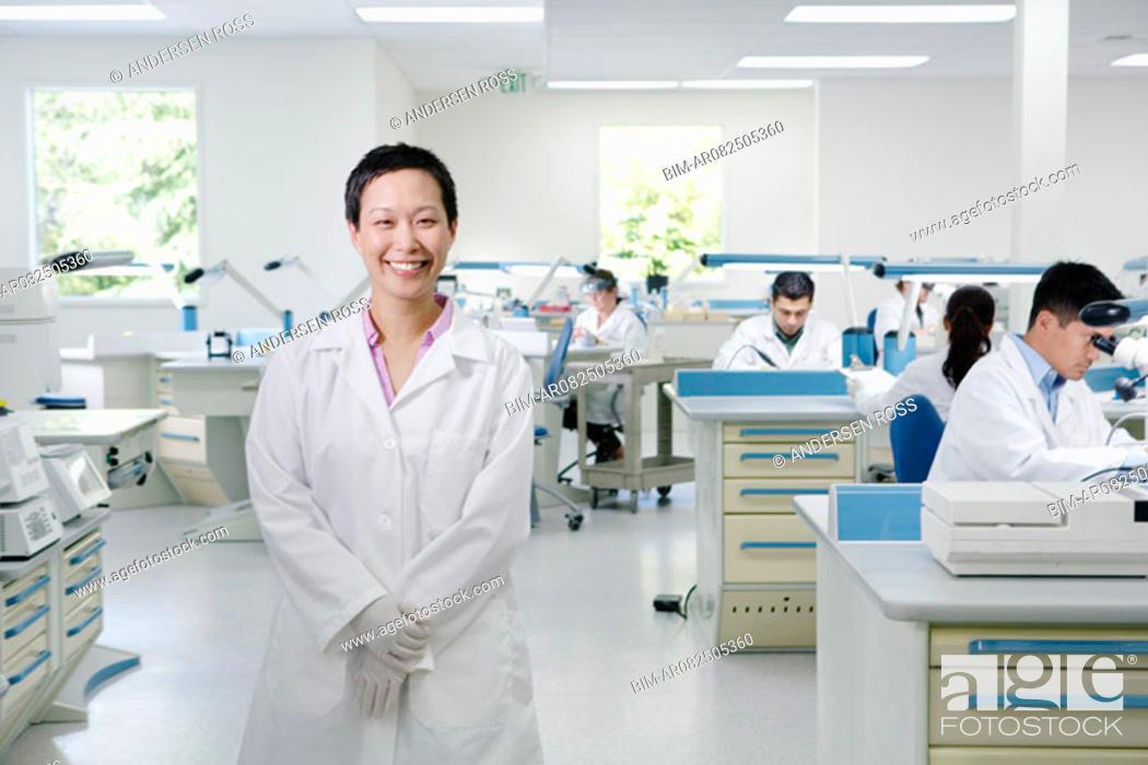 Stock Photo: Portrait of female technician in lab.