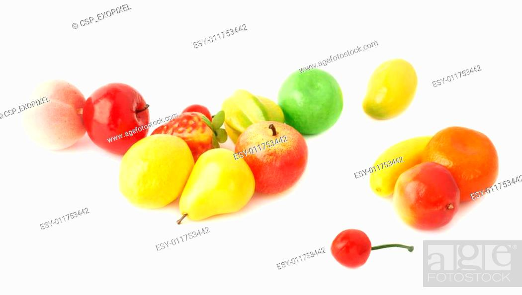 Stock Photo: Pile of multiple artificial plastic fruits and berries.