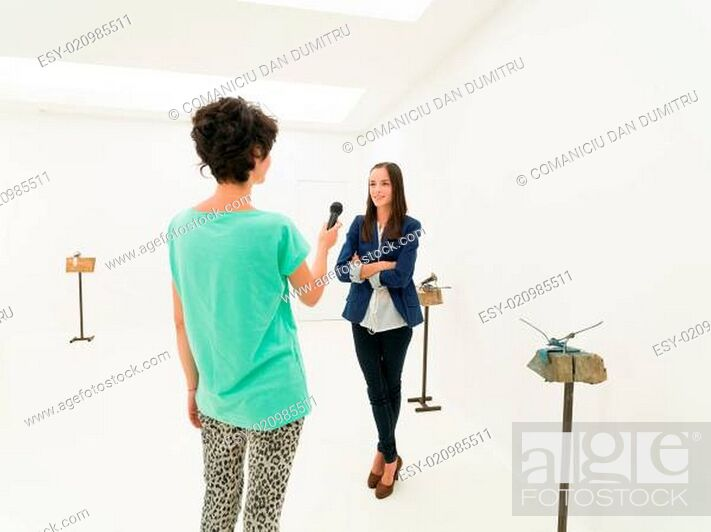 Stock Photo: talking with the artist about the exhibition.