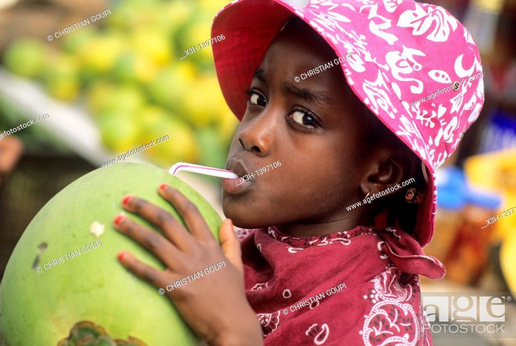 Stock Photo: enfant buvant du jus de coco Ile de la Martinique Departement et Region d'Outremer francais Archipel des Antilles Caraibes//kid drinking coconut water.