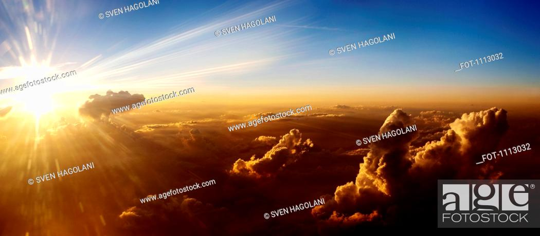 Stock Photo: Sun rising on clouds, aerial view.