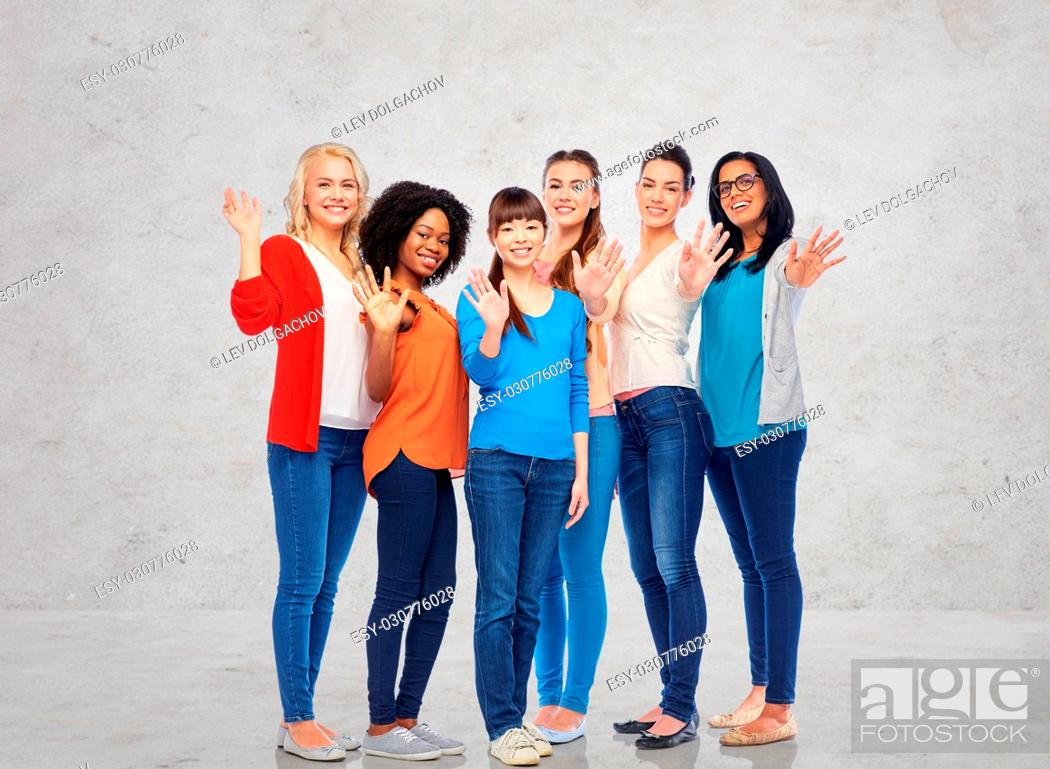 Stock Photo: diversity, race, ethnicity, gesture and people concept - international group of happy smiling different women waving hands over gray concrete wall background.