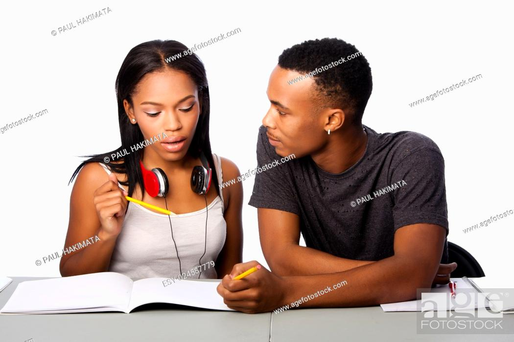 Stock Photo: Two students happily studying together, on white.