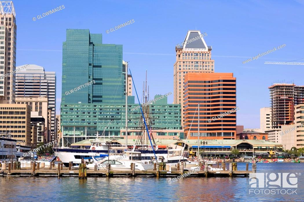 Stock Photo: Boats moored at a harbor, Inner Harbor, Baltimore, Maryland, USA.