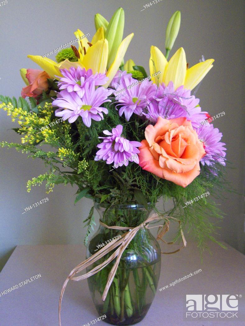Stock Photo: Flower arraingment in glass vase.
