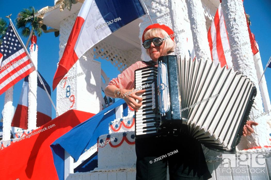A female accordion player performing at the French