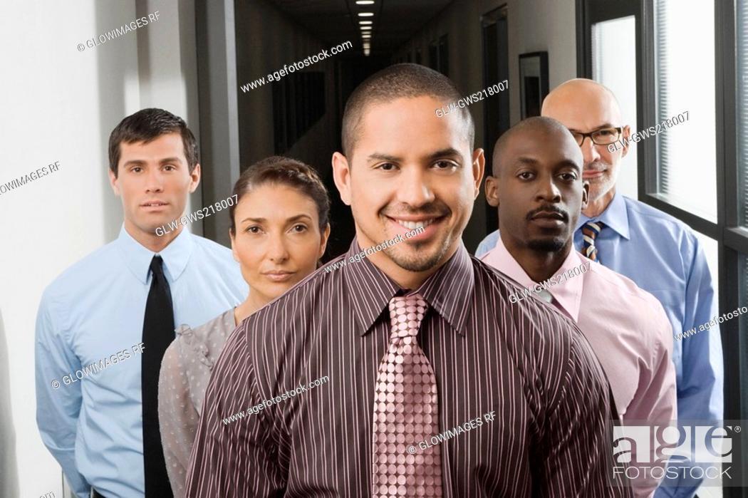 Stock Photo: Business executives standing in a corridor.